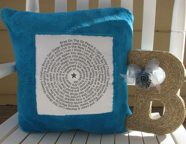 pillow and yarn wrapped letter