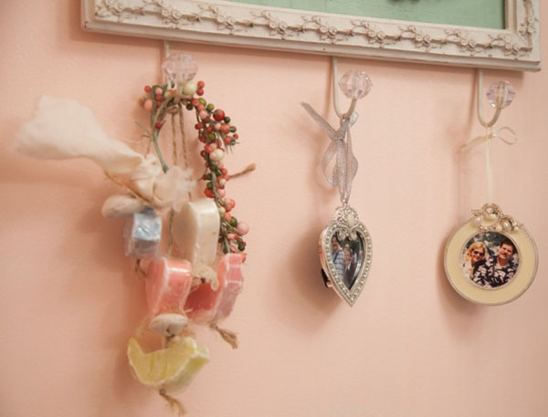Hanging fragrant soaps and photos of her husband add personal touches to this craft room.