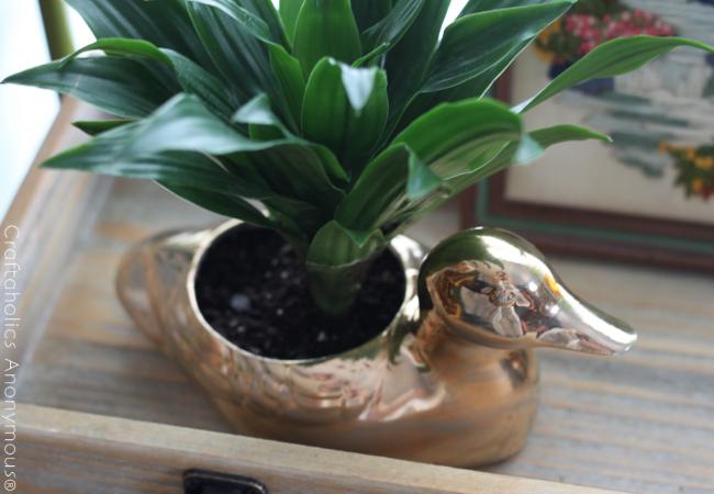 metallic duck planter.