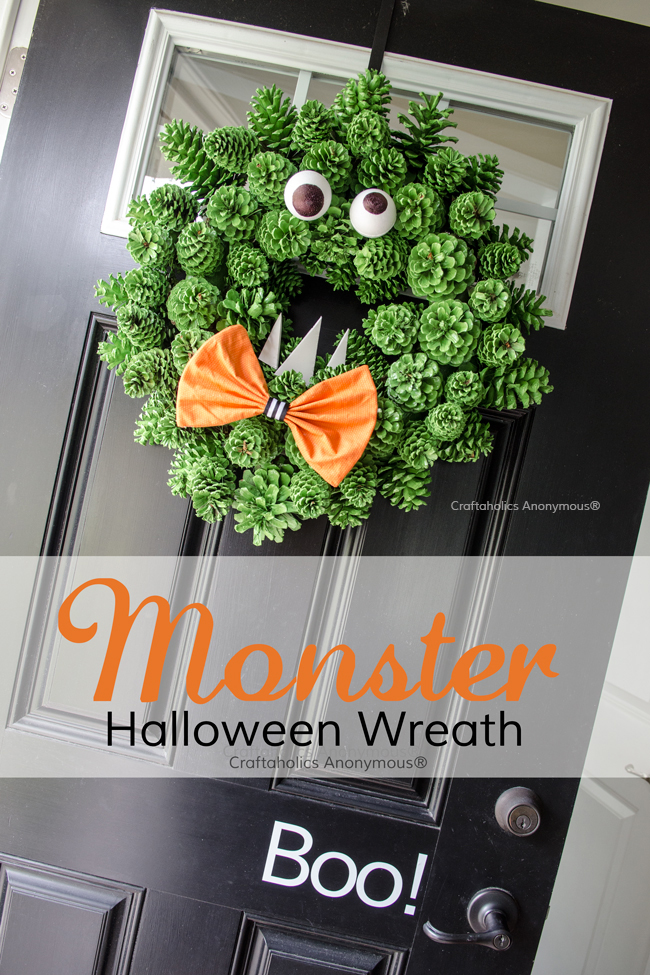 Love this Halloween Monster Wreath made with pinecones. The texture is perfect!
