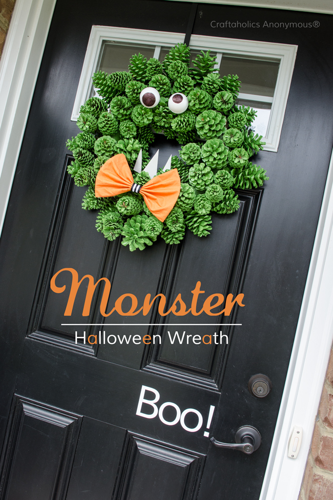 Pinecone monster Halloween Wreath idea. Super cute and easy DIY wreath! The texture is awesome.