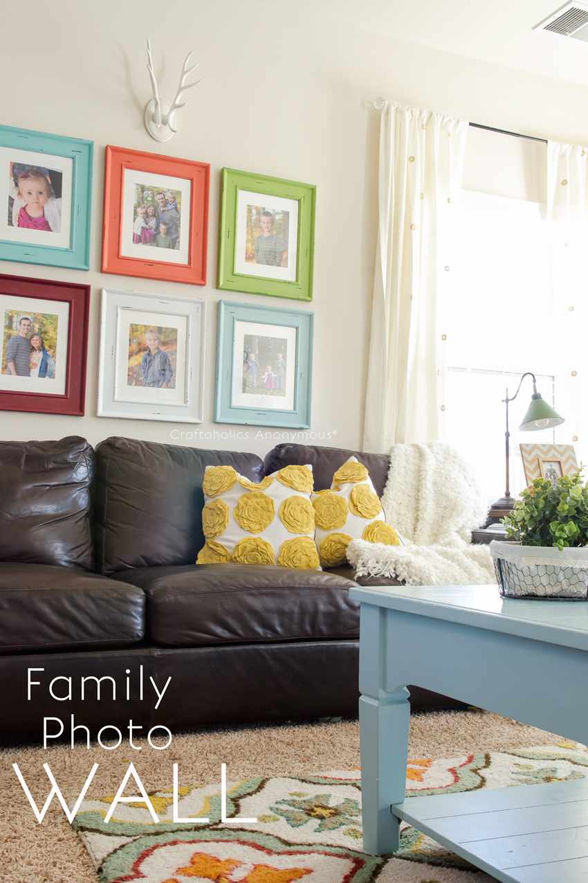 Family Photo Wall || love the colorful picture frames!