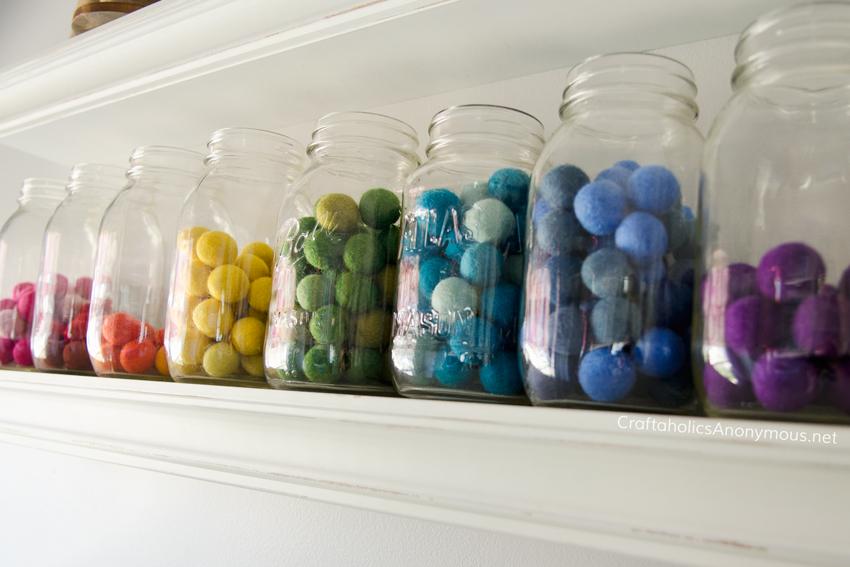 Store felt balls in mason jars + lots of craft room storage ideas on www.CraftaholicsAnonymous.net