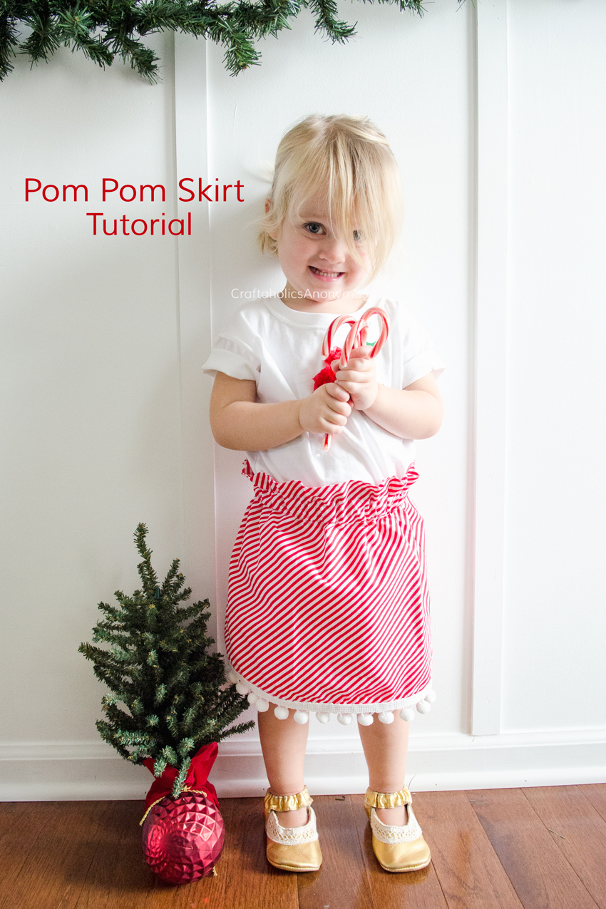 Easy Pom Pom Skirt tutorial. Whips up in about 1 hour! Free easy sewing pattern. Love the Christmas theme with Candy cane stripes and white poms. www.CraftaholicsAnonymous.net