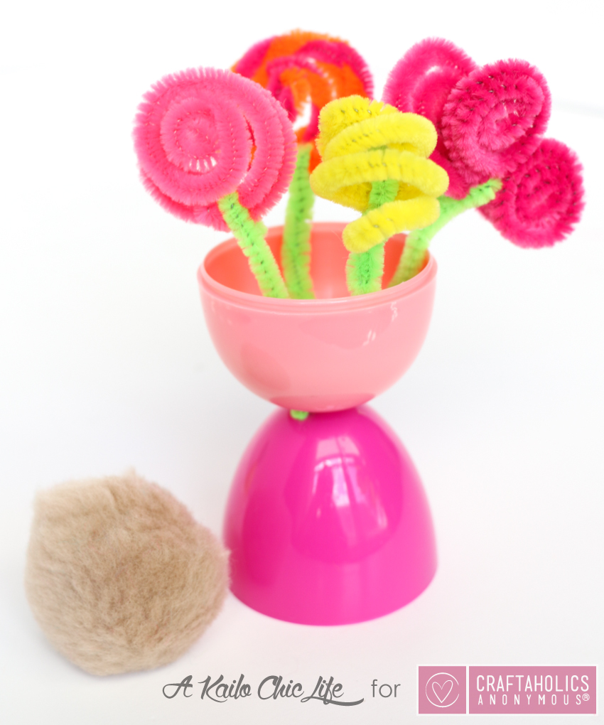 Kid Friendly Spring Flower Vase craft using plastic Easter eggs and pipe cleaners