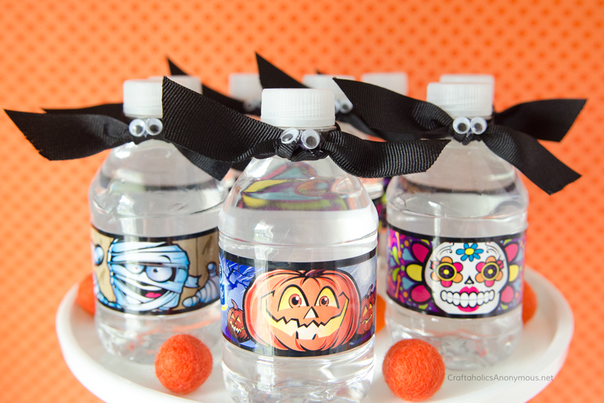 Simple ribbon bats on for Halloween Water bottles. Great for parties or trick-or-treating!