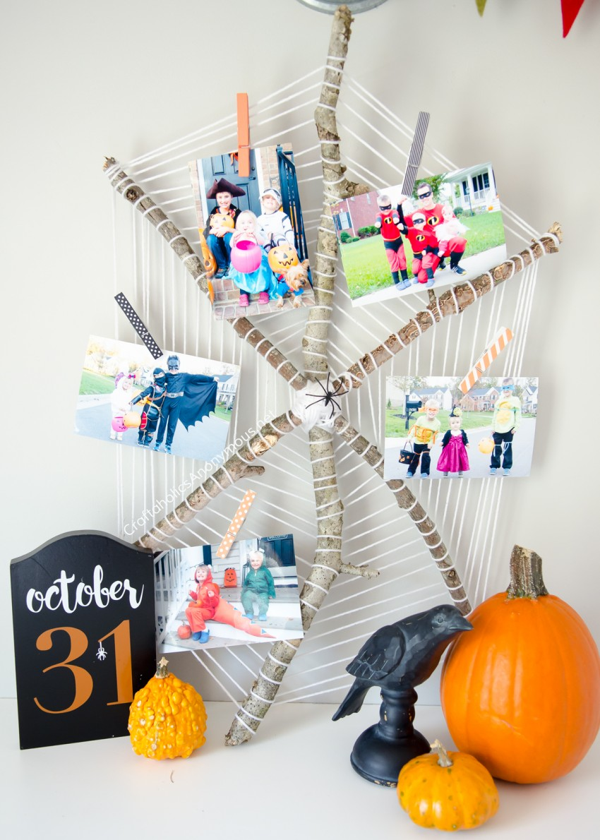 DIY Halloween Spider Web Photo Display :: perfect to show off previous Halloween costumes!